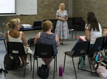 Participants sitting in a circle during a 2018 LAMDA exams summer workshop